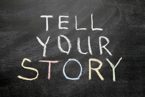 tell your story phrase handwritten on the school blackboard